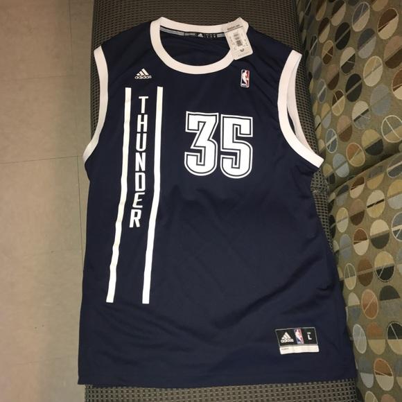 010870827 Kevin Durant Oklahoma City Thunder OKC blue jersey. NWT. adidas.  40  75.  Size. L